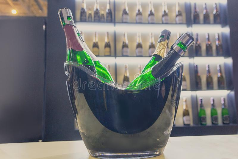 Bottles with sparkling wine on a counter of wine shop stock photos