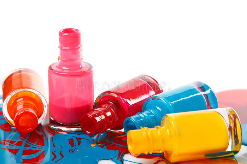 Bottles with spilled nail polish stock photos