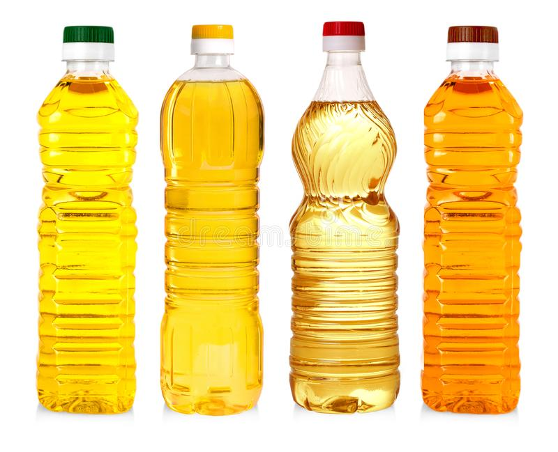 Bottles of sunflower oil isolated on white background. royalty free stock images