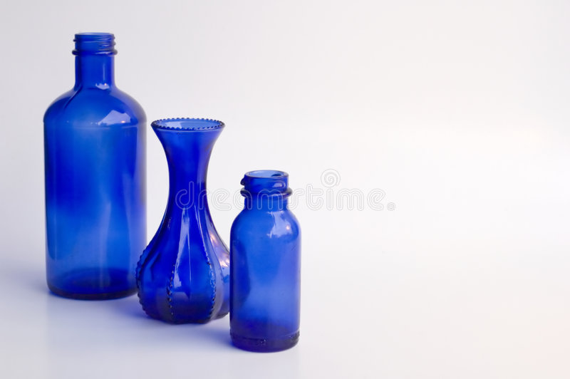 Bottles (three) of various sizes stock images
