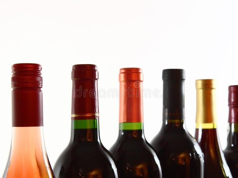 Bottles Of Various Wines Closeup Stock Photos
