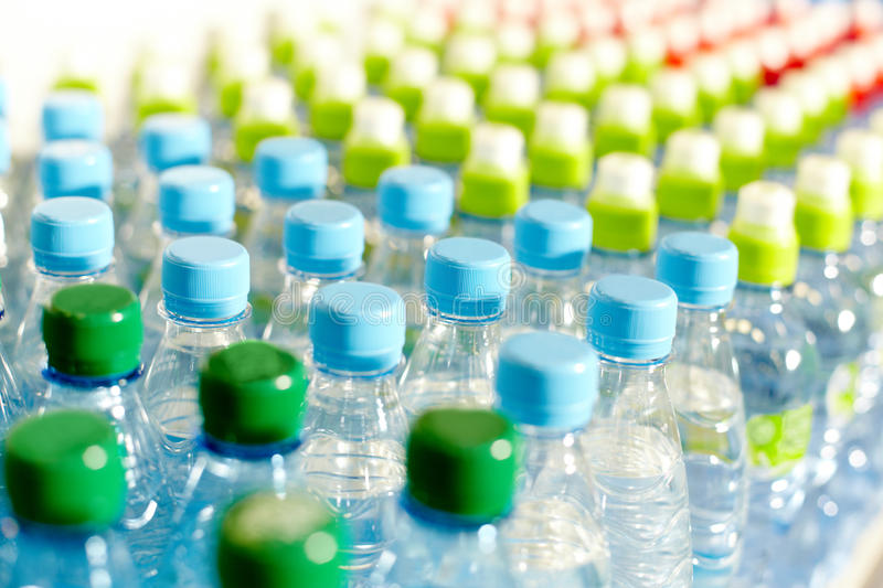 Bottles with water. Image of many plastic bottles with water in a shop stock photography