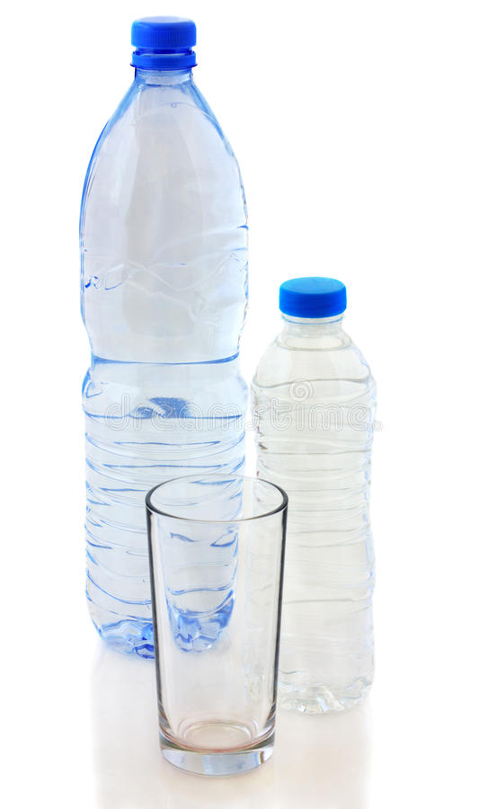 Bottles of water and glass royalty free stock photos