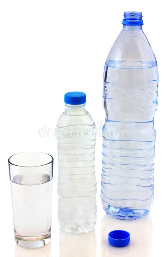 Bottles of water and glass royalty free stock photo