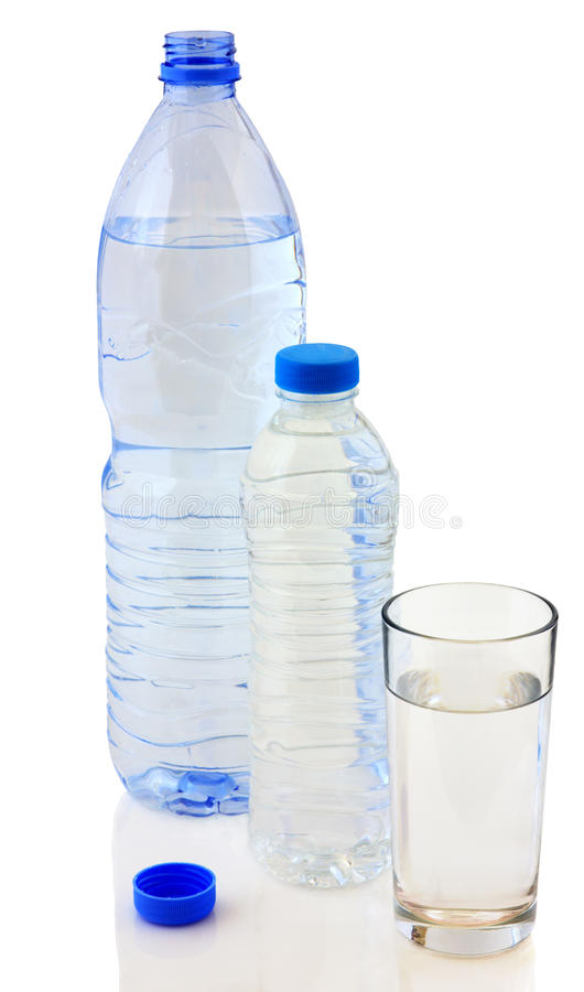 Bottles of water and glass stock photos