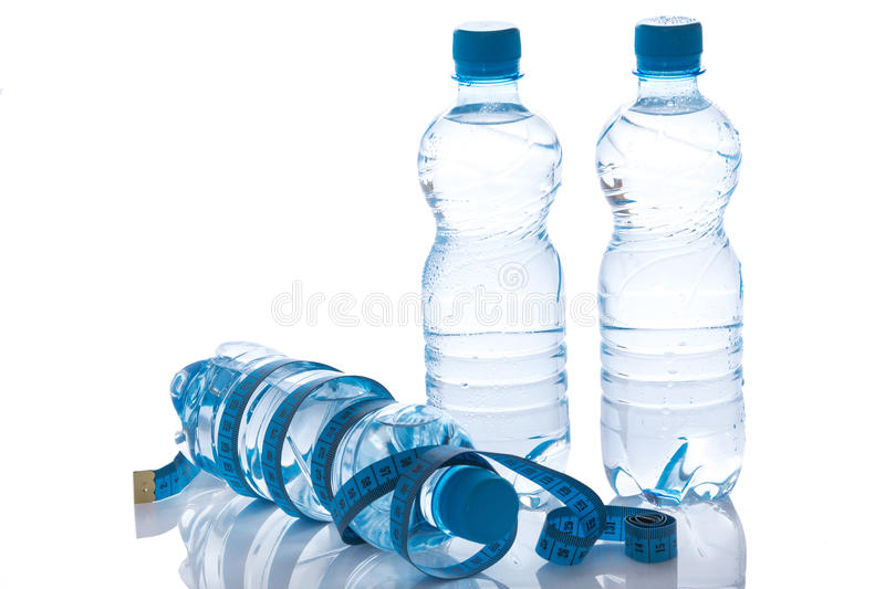 Bottles with water. On white background royalty free stock images