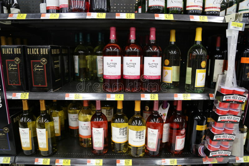 Bottles of wine. Wine (from Latin vinum) is an alcoholic beverage made from fermented grapes or other fruits. Due to the natural chemical balance, grapes ferment royalty free stock photo