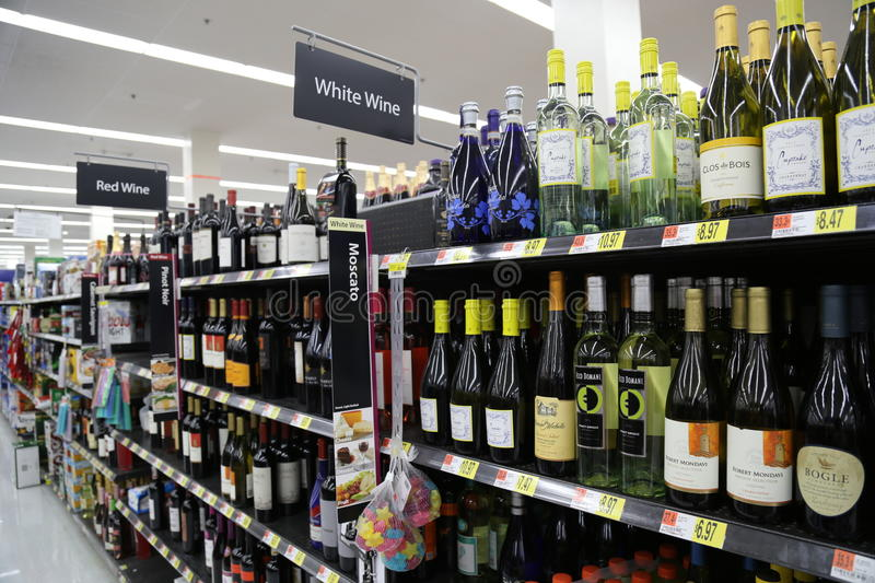 Bottles of wine. Wine (from Latin vinum) is an alcoholic beverage made from fermented grapes or other fruits. Due to the natural chemical balance, grapes ferment royalty free stock photos