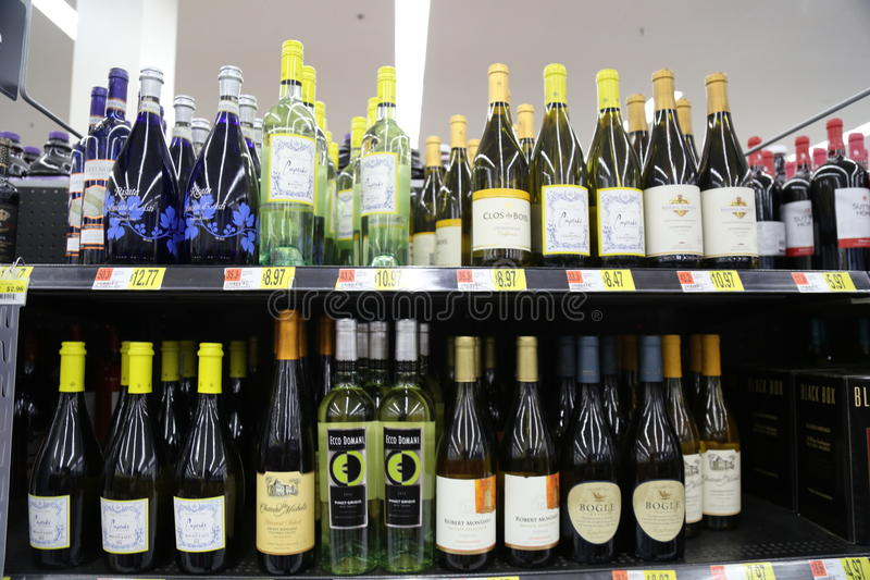Bottles of wine. Wine (from Latin vinum) is an alcoholic beverage made from fermented grapes or other fruits. Due to the natural chemical balance, grapes ferment royalty free stock images