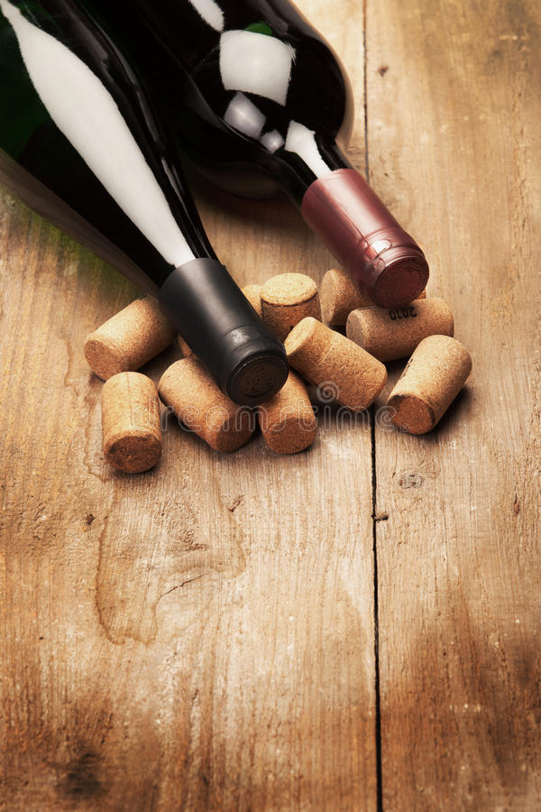 Bottles of Wine on Wood with cork royalty free stock image