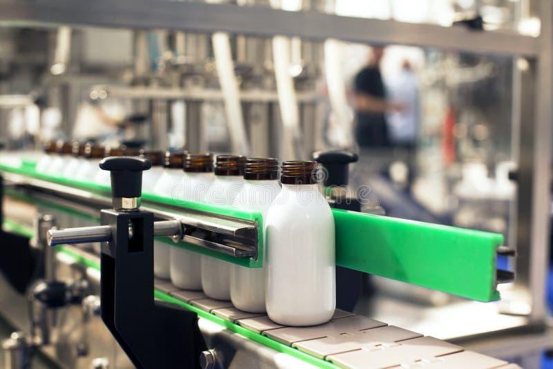 Bottling line. White bottles in a bottling line royalty free stock photo