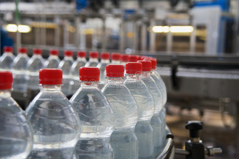 Bottling. Of mineral water in plastic bottles royalty free stock photography