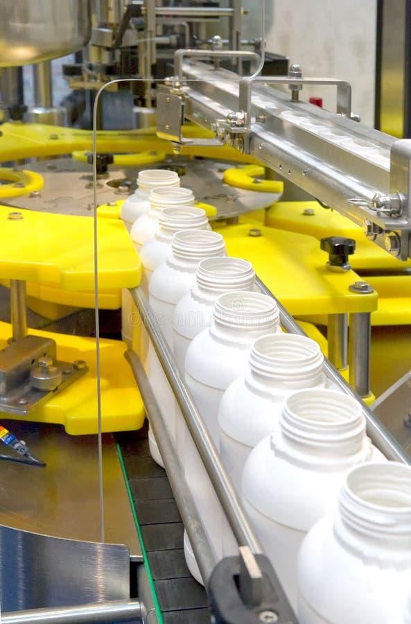 Bottling plant. A Bottling plant with white bottles stock image