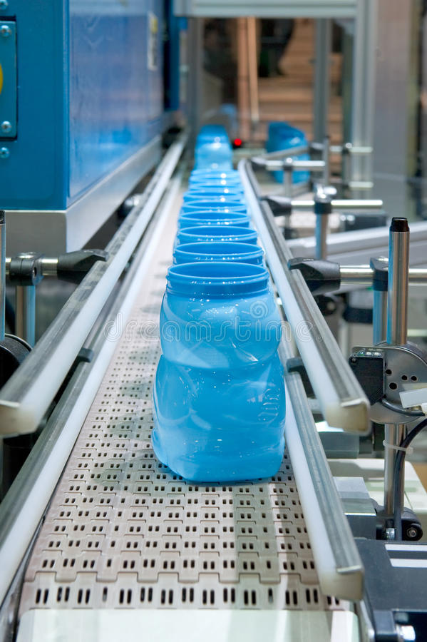 Bottling plant. A Bottling plant with blue bottles royalty free stock photography