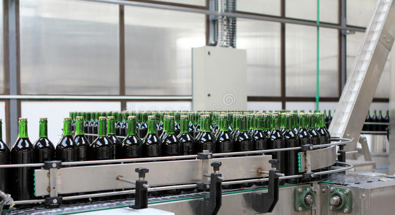 Bottling plant. View at the sorting process in a bottling plant royalty free stock photo