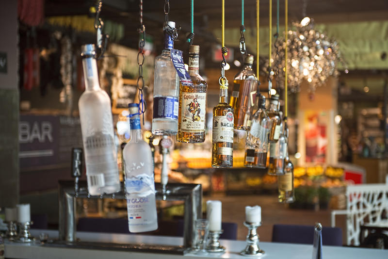 Bottlles in a trendy bar. Hanging bottles on a display in a trendy bar stock images