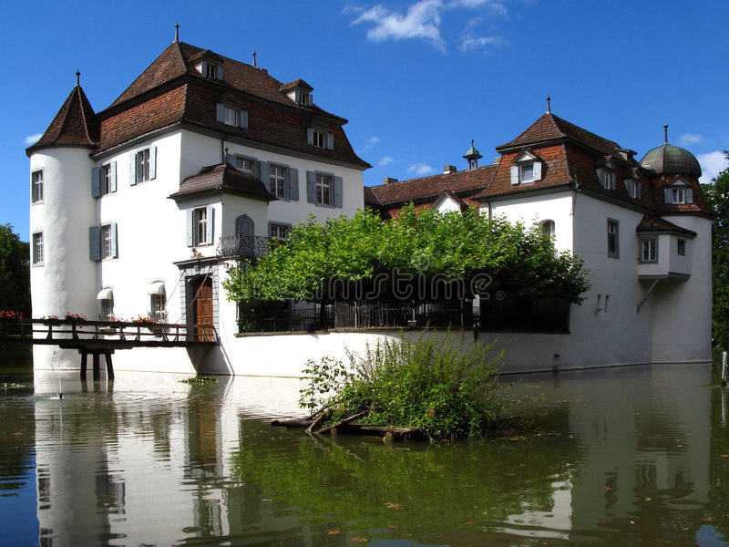 Bottmingen Castle, near Basel, Switzerland. A romantic castle with a sourounding moat in the country-side of Basel, Switzerland stock photos