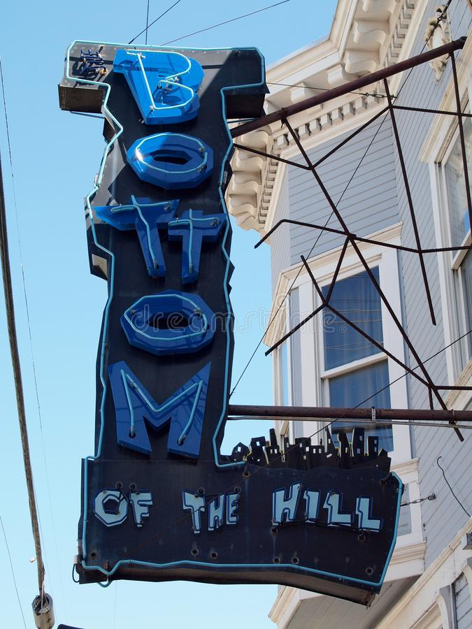 Bottom of the Hill Neon Sign in the Day royalty free stock photos