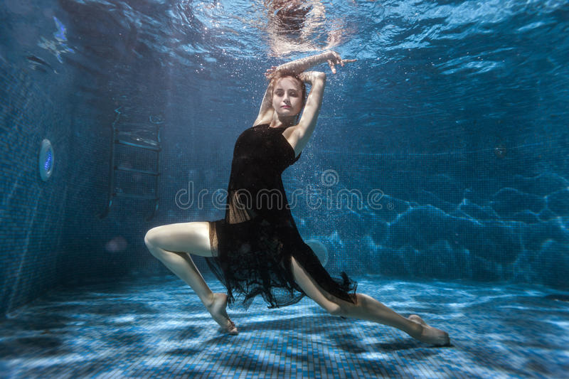 Download At The Bottom Pool, A Woman Dances Under Water. Stock Photo - Image of snorkeling, liquid: 92207786