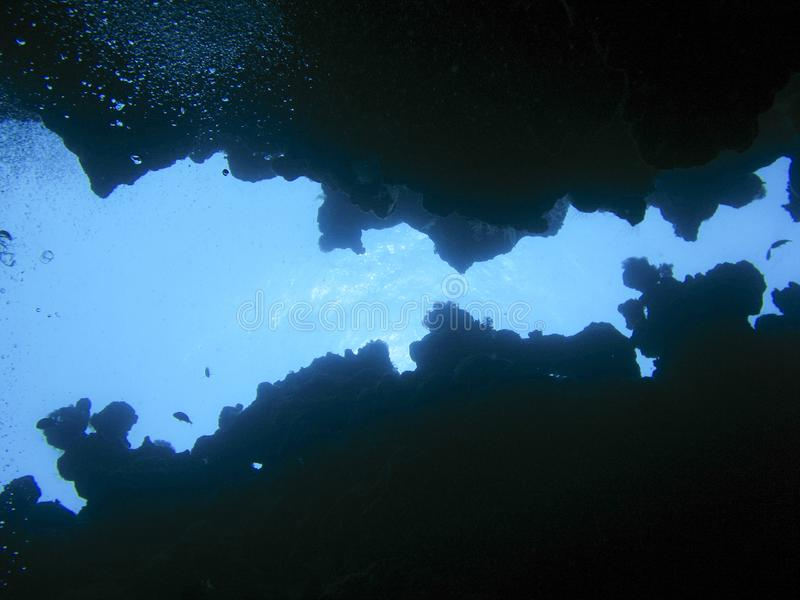 At the bottom of an underwater canyon in Dahab, Egypt. At the bottom of the spectacular divesite The Canyon looking upwards to the surface where the light is stock photo
