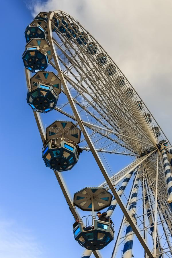 Bottom up view of the ferris wheel situated at the end of La Concha beach promenade heading to. San Sebastian, Spain - Jan 2019: Bottom up view of the ferris royalty free stock photography