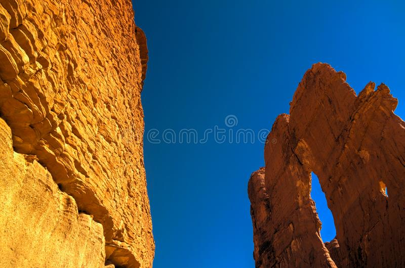 Bottom-up view to Abstract Rock formation at plateau Ennedi aka stone forest in Chad royalty free stock image