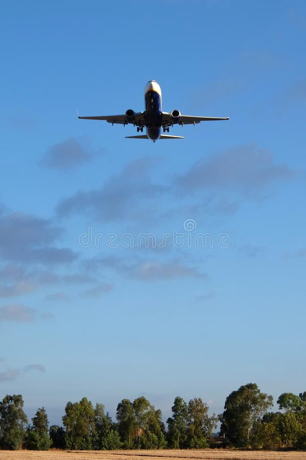 Bottom view of airplane flying above the fields near airport Rome-Fiumicino stock photo