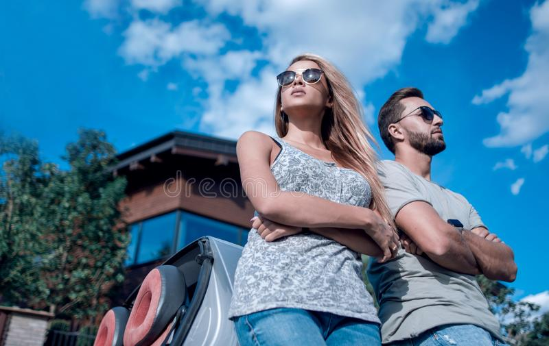 Bottom view.beautiful couple standing near a convertible car stock images