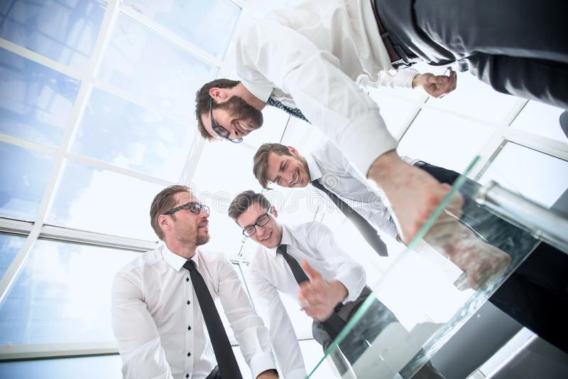 Bottom view.business team looking for a signed contract royalty free stock photos