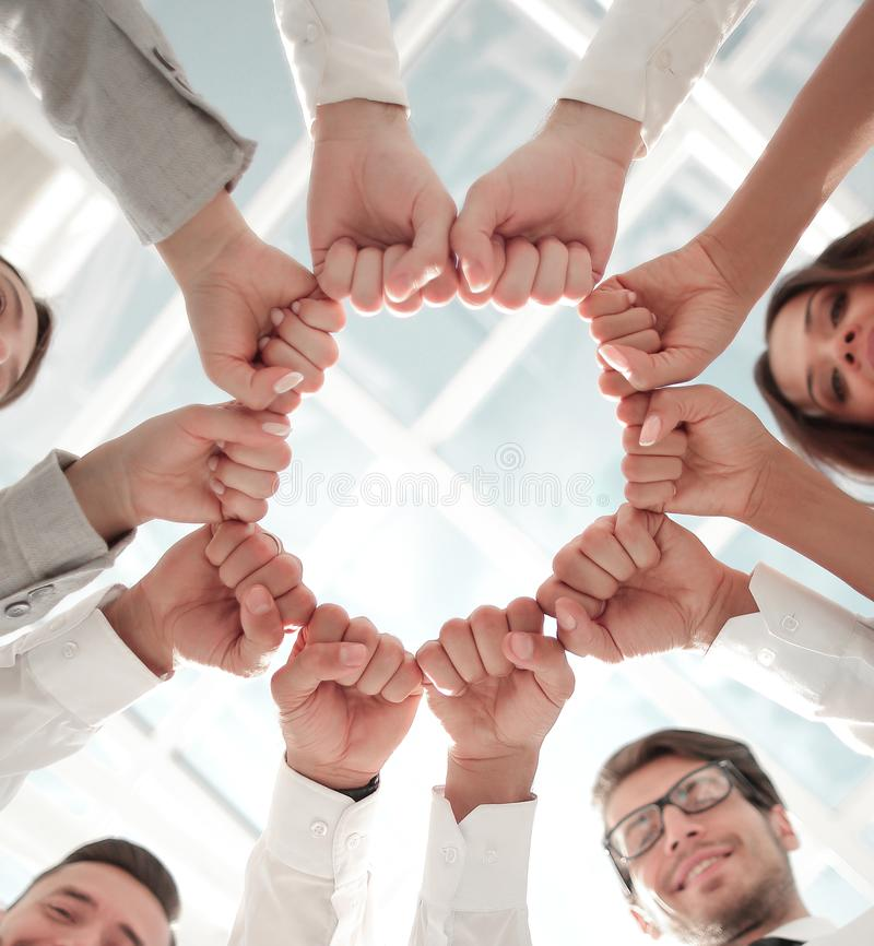 Bottom view. business team standing in a circle. royalty free stock photos