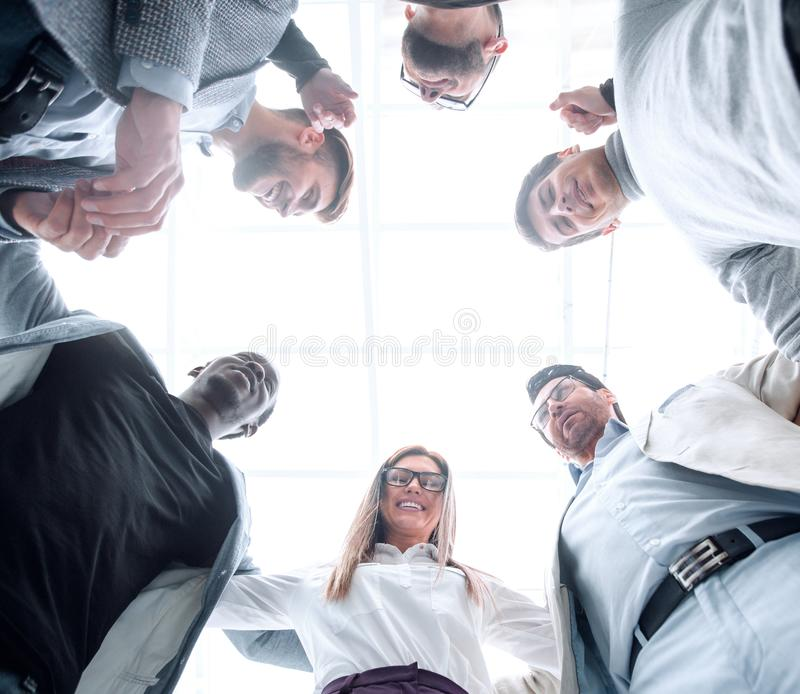 Bottom view.business team standing together stock image