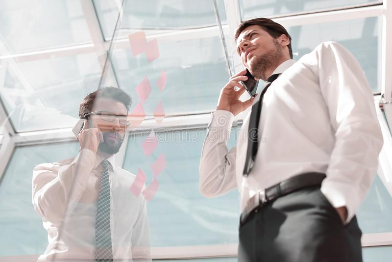 Bottom view.businessman talking on mobile in the office stock images