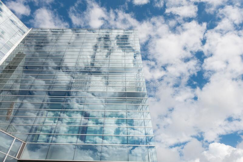 Bottom View of Clear Glass Building Under Blue Cloudy Sky during Day Time stock photo