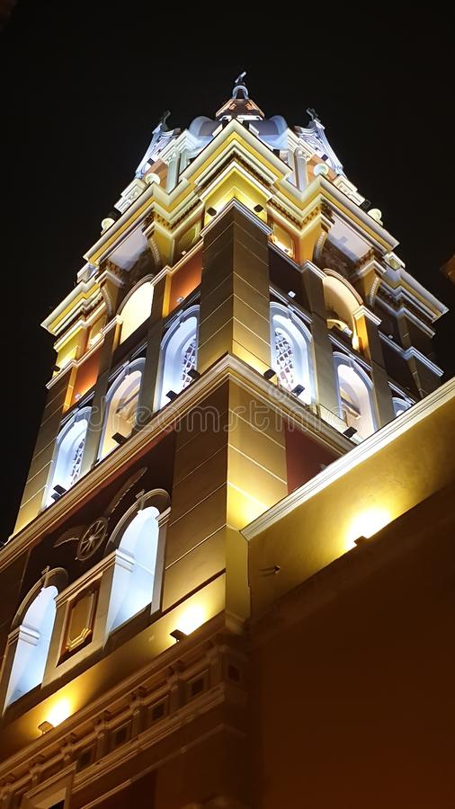 Bottom view of the colorful tower of the cathedral at night, Cartagena, Colombia stock photos