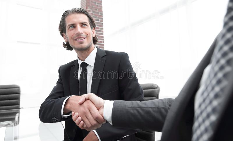 Bottom view. confident handshake of business partners stock photography