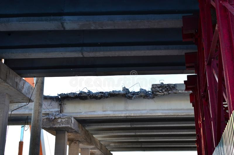 Disassembled, collapsed, emergency bridge of the highway. Danger zone at the construction site. Dismantling of. Bottom view of the disassembled, collapsed stock photos