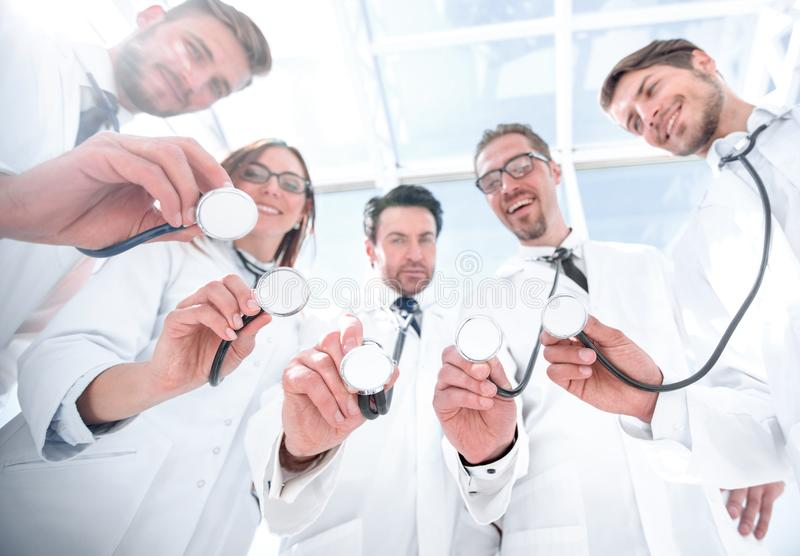 Bottom view.a group of doctors have put their stethoscopes together stock photography