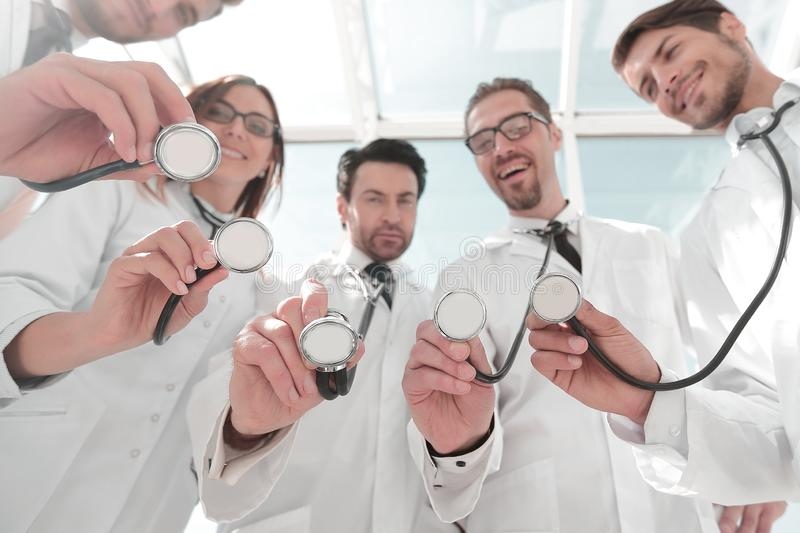 Bottom view.a group of doctors have put their stethoscopes together stock photos