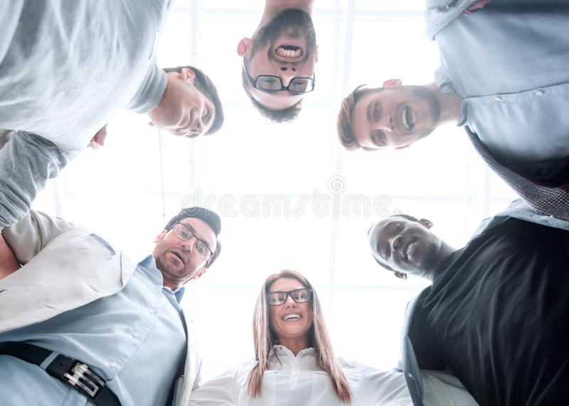 Bottom view.a group of young people stand together, forming a circle royalty free stock image