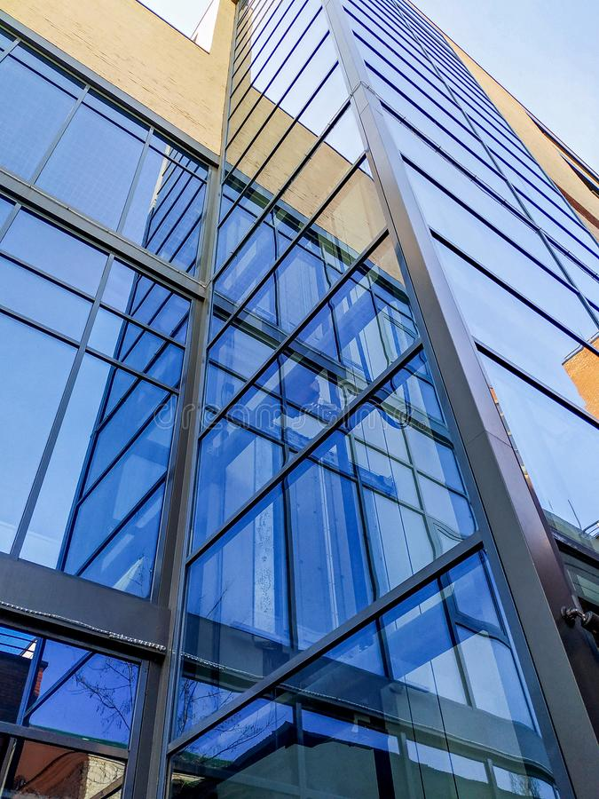 Bottom view on modern building with glass Windows. Abstract, office, architecture, business, city, financial, background, futuristic, high, skyline, tall royalty free stock image