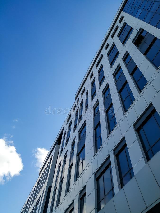 Bottom view on modern building with glass windows. Abstract, office, architecture, business, city, financial, background, futuristic, high, skyline, tall royalty free stock photography