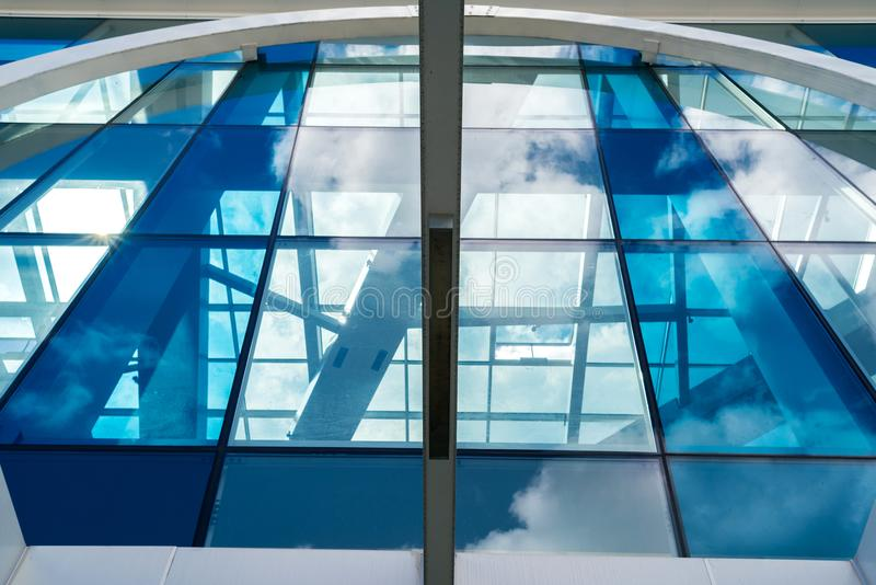 Bottom view of modern glass blue business centre architecture stock photography