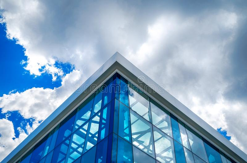 Bottom view of modern glass blue business centre architecture. stock image