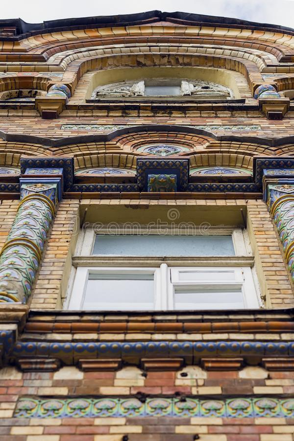Bottom view window of old, historical building. Front of structure, edifice with classical mosaic architecture style. Bottom view of old, historical building royalty free stock images