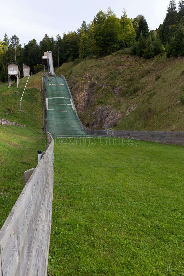Ski jumping slope and tracks on summer stock images