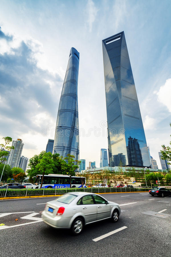 Bottom view of skyscrapers in downtown of Shanghai, China. SHANGHAI, CHINA - OCTOBER 31, 2015: Bottom view of the Shanghai Tower and the Shanghai World Financial stock photography