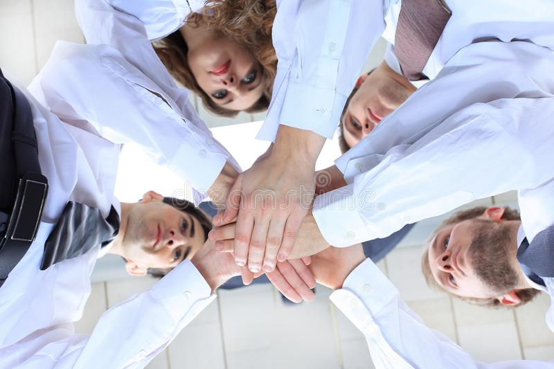 Bottom view.a successful and professional business team.close-up. royalty free stock photo