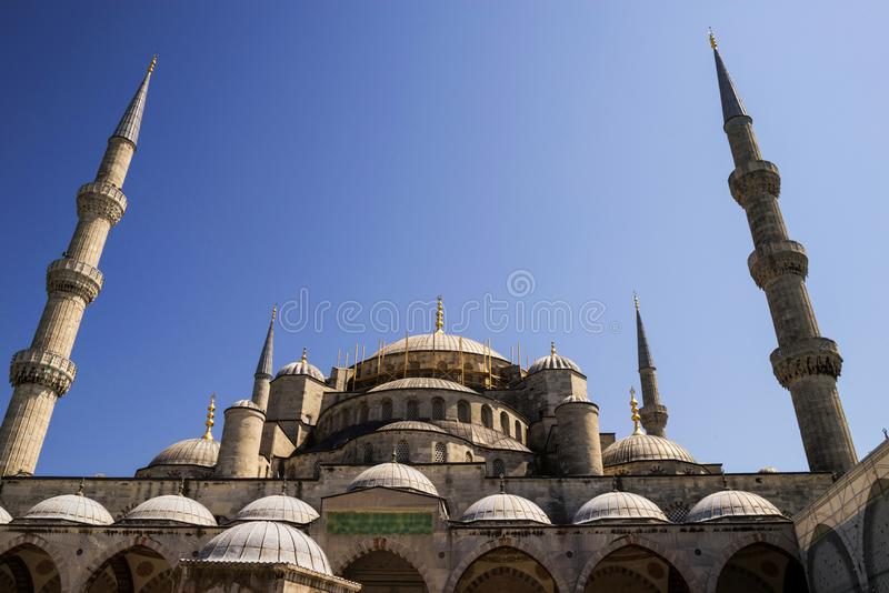 Bottom view of the Suleymaniye Mosque with two minarets against a blue sky royalty free stock photos