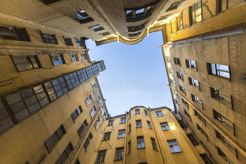 Bottom view on a typical courtyard-a well in the old district of St. Petersburg royalty free stock photos