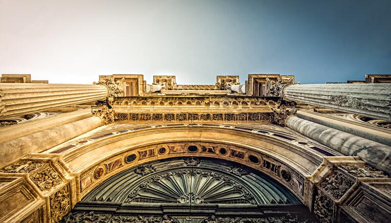 Bottom View of Vintage Arch during Daytime royalty free stock images